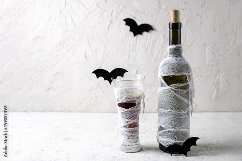 Fotografiet Glass and Bottle of cocktail decorated as mummy