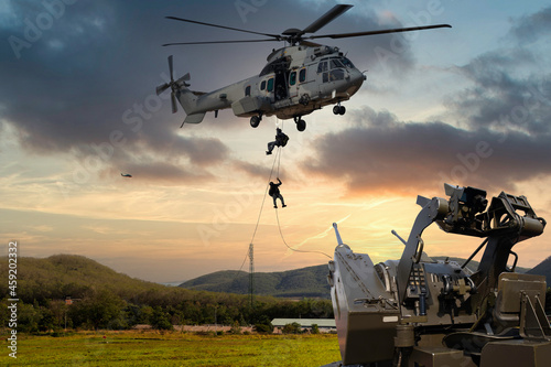 Anti Aircraft gun with military commando helicopter drops between are in flight Fototapet