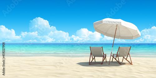 Slika na platnu Chaise lounge and umbrella on sand beach.