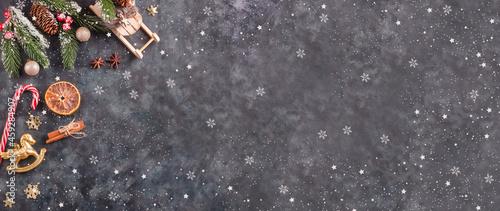 Fotografie, Obraz Christmas background banner, festive Christmas decorations on a black background