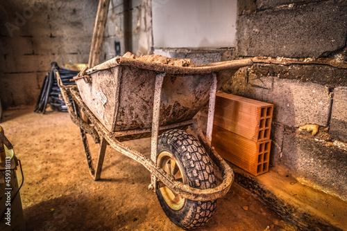 Canvas Dirty wheelbarrow in a construction site