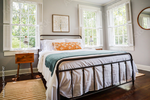 Canvas A guest bedroom with a queen sized bed and nightstand at a short term rental sma