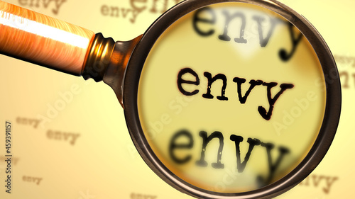 Photo Envy - abstract concept and a magnifying glass enlarging English word Envy to sy