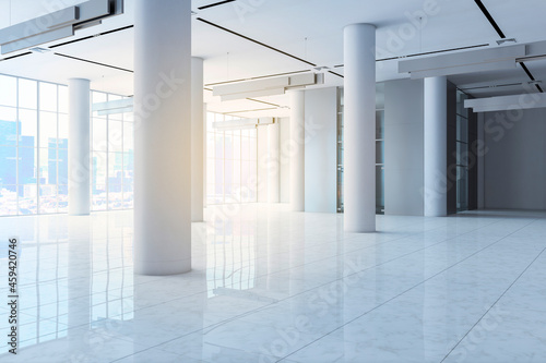 Fotografie, Obraz Empty white concrete hall interior with columns, city view, daylight and reflections on floor