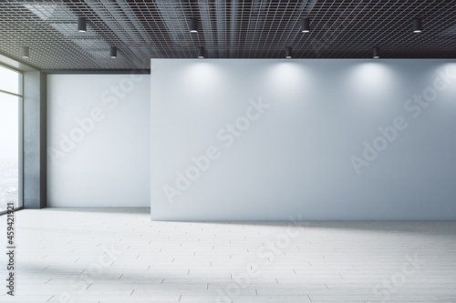 New empty interior with blank mock up place on wall, windows, city view and daylight. Design and gallery concept. 3D Rendering.