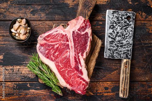 Canvas Print Italian Florentine T-bone beef meat Steak with herbs on a wooden cutting board