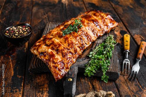 Obraz na plátně BBQ grilled pork spare ribs on a cutting board