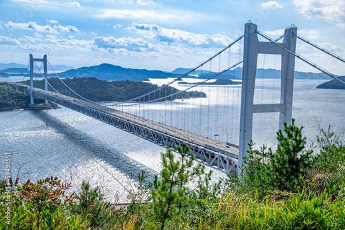 瀬戸大橋とキラキラと輝く海面の風景 岡山県倉敷市 The view of Seto Ohashi bridge at Setonaikai, Inland Sea of Japan, in Kurashiki city, Okayama pref Fototapete