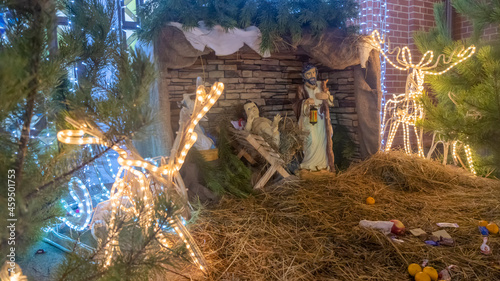 Fotografie, Obraz Christmas nativity scene with baby Jesus, Mary and Joseph in the manger with sheeps