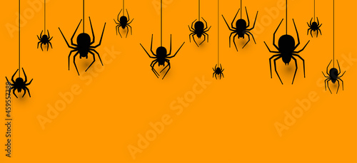 Canvas Print Hanging spiders halloween orange background.