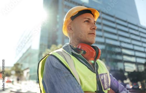 Billede på lærred Blue collar worker looking thoughtful in the city
