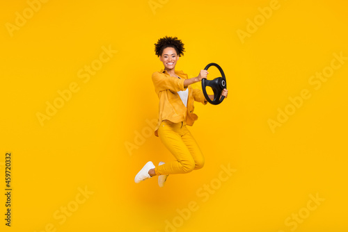 Full length body size photo woman jumping keeping steering wheel isolated vivid Fototapet