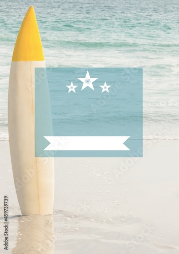 Composition of blue frame over yellow surfboard on beach
