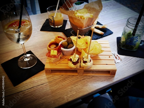 Billede på lærred table with platters of aperitifs with snacks and drinks to drink in a restaurant