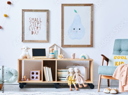 Canvastavla Cozy interior of child room with mint armchair, brown mock up poster frame, toys, teddy bear, dolls, plush animal, decoration