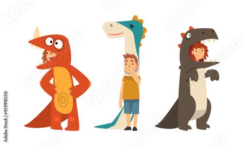 Fotografiet Cute Kid Wearing Dinosaur Costume as Carnival Outfit Vector Set