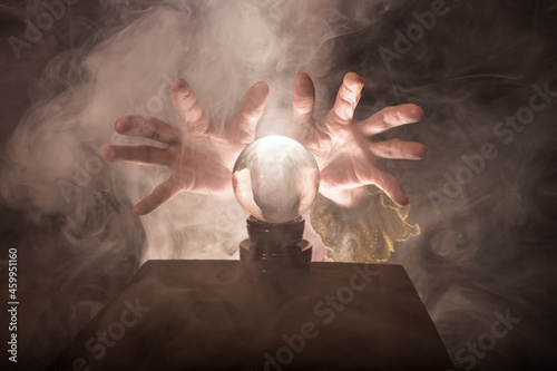 Fotografia A fortune teller's hands conjure up a crystal ball
