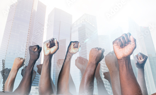 Foto Raised hands of african american men clenched into fists on light background