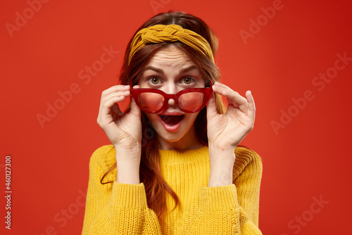 Fotografiet pretty woman in red glasses headband hipster fashion posing