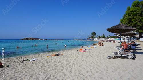 Fotografie, Obraz cyprus beach straw umbrellas sun loungers recreation garden resort summer