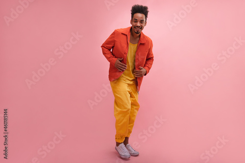 Full length shot handsome cheerful afro man standing up straight and looking at camera with copy space Fototapet