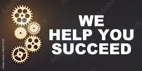 On a black background, gears and the inscription - We Help You Succeed