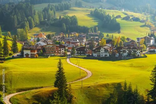Obraz na plátně Cozy little mountain village on the hilltop in the background of the Dolomites m