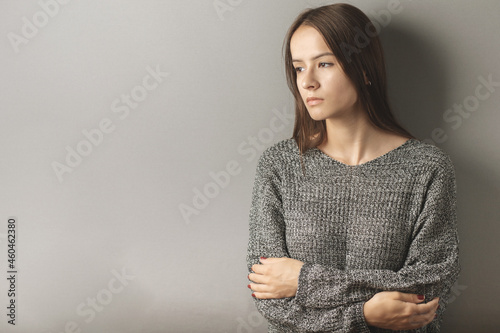 Tablou Canvas adolescent abuse,unhappy sad teenage girl stands with her arms crossed, crying,