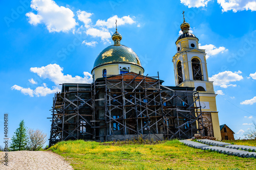 Fototapeta Reconstruction of the old orthodox church in ukrainian countryside