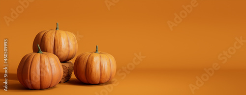 Fototapete Seasonal background Banner with copy-space. Trio of Pumpkins on Orange color. Fall Concept.