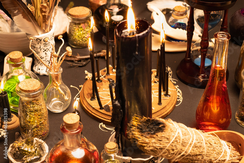 Fototapeta Witchcraft still life with black burning candles selective focus