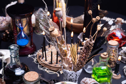 Fototapeta Witchcraft still life with witch weeds selective focus at front