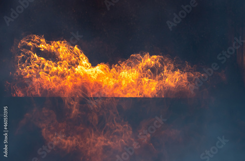 Wallpaper Mural Blaze fire flame texture background,Light and life,Fiery orange glowing flying away particles over black