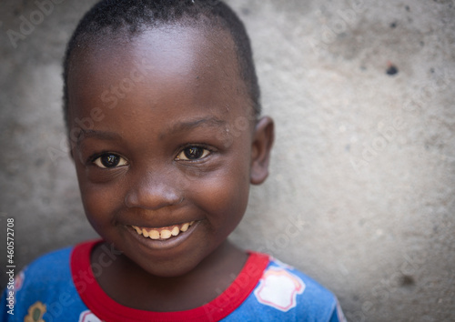 Fototapeta African black boy portrait standing near his poor house alone