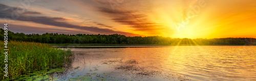 Obraz na plátně Beautiful summer sunrise over lake