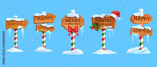 Obraz na plátně Christmas wooden sigh board set, vector x-mas North Pole road pointer, Santa Claus workshop arrow