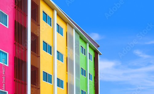 Cuadros en Lienzo Part of modern colorful building with many windows and balusters lines against b