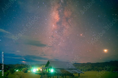 Fotografie, Obraz The Milky way in night sky over the hut in the middle of paddy field at Mae Hong