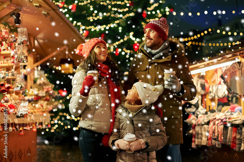 Canvas family, winter holidays and celebration concept - happy mother, father and littl