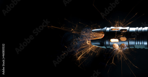 Fotografie, Obraz Sparks flying from the barrel of an assault rifle