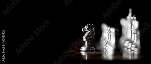 Photo Pieces on chess board for playing game and strategy