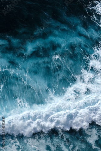 Wallpaper Mural Aerial view to seething waves with foam