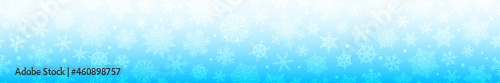 Photo Christmas horizontal  banner of big and small complex snowflakes with seamless horizontal repetition, in light blue colors