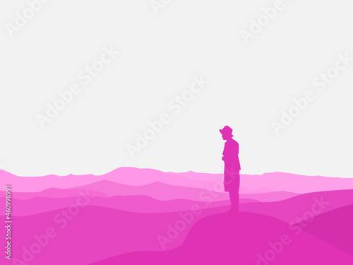 Fototapeta man standing on a rock raising his hand