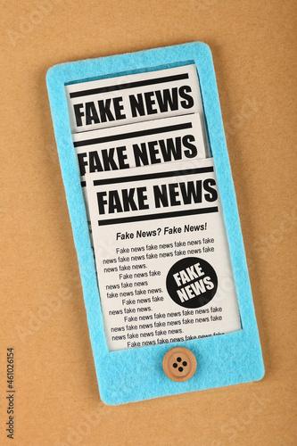 Photo Felt craft smartphone with FAKE NEWS newspapers