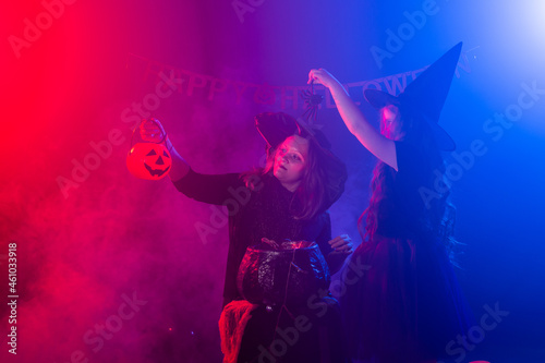 Two halloween witches making a potion and conjure in halloween night Fototapeta
