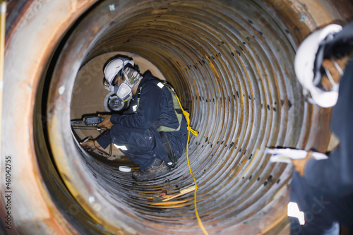 Male worker inspection measured the coil pipe circular thickness of the boiler s Fototapeta