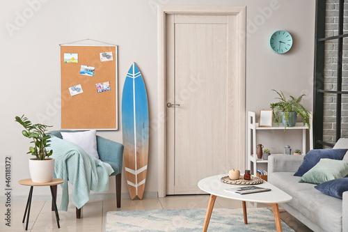 Tela Interior of stylish room with surfboard