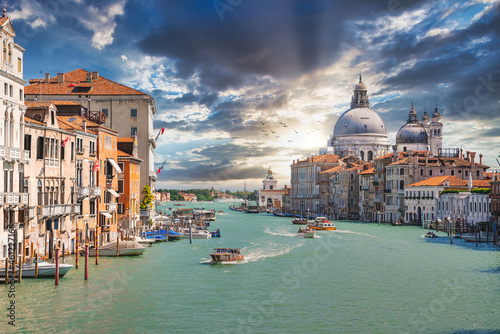Old cathedral of Santa Maria della Salute in Venice, Italy at sunset. The most popular cathedral in Venice - Santa Maria della Salute church at sunset.