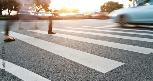 Foto Group of people walking on the crosswalk